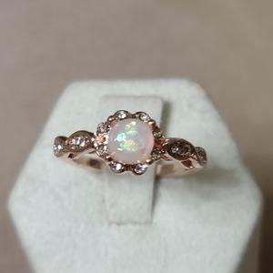 Size 7 fire opal stone/14k rose gold w diamonds